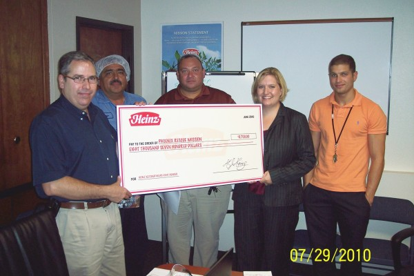 Todd's Foods check presentation to the Phoenix Rescue Mission